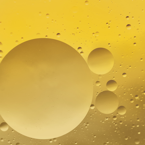 Psychedelic blueand yellow oil and water abstract background. Abstract colorful background. Foam of Soap with Bubbles macro shot. Closeup bubbles in water. Oil drops on a water surface blue and yellow